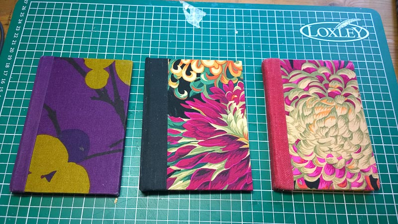 Cotton scraps can be used to make notebooks. It is also a good way to use cardboard from old sketchbooks.