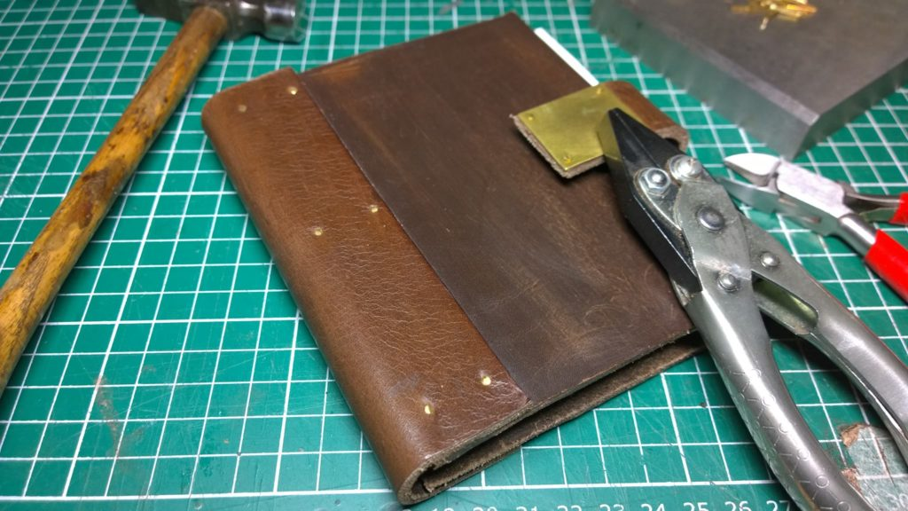 Notebook made from leather offcuts from Ebay. The leather was too thick to sew so I have glued and riveted it instead.